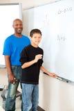 Profesor del afroamericano con el estudiante Fotos de archivo