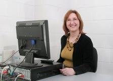 Profesor en el ordenador Fotos de archivo libres de regalías