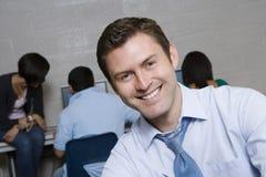 Profesor feliz In Computer Lab Foto de archivo libre de regalías