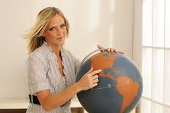 Profesor joven en el globo Foto de archivo libre de regalías