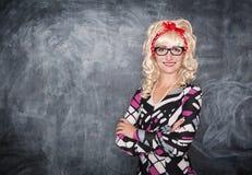 Profesor retro en la sonrisa de los vidrios foto de archivo