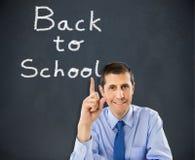 Profesor wskazuje z powrotem szkoła Zdjęcia Stock