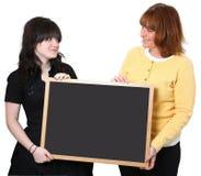Profesor y estudiante con la pizarra Fotografía de archivo libre de regalías