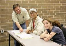 Profesor y estudiantes Imagenes de archivo