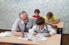 Profesor y niños Foto de archivo libre de regalías