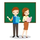 Profesores que se colocan en sala de clase Imagen de archivo libre de regalías