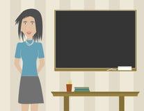 Professeur de femme dans une salle de classe Image libre de droits