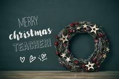 Professeur de Joyeux Noël de guirlande et de textes images stock