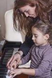 Professeur de piano image libre de droits