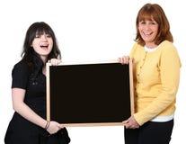 Professeur et étudiant avec le tableau au-dessus du blanc Image stock