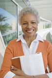 Professeur féminin heureux With Book Photographie stock