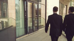 Professioanl businessmen entering the office building stock footage