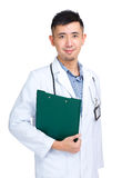 Profession asian doctor holding clipboard Royalty Free Stock Photo