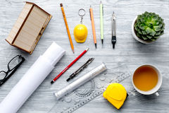 Profession concept with architect desk and tools wooden background top view Stock Photo