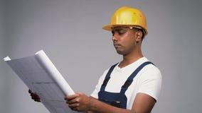 Happy indian builder in helmet with blueprint stock video footage