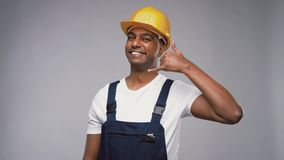 Happy worker or builder making phone call gesture stock video