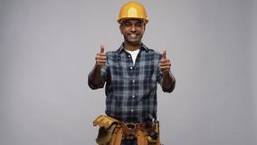Happy indian worker or builder showing thumbs up stock video footage
