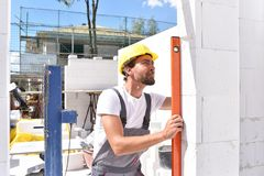 Profession construction worker - work on a building site construction of a residential house royalty free stock photography