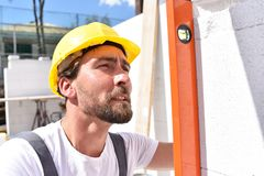 Profession construction worker - work on a building site construction of a residential house stock photos