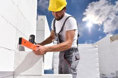 Profession construction worker - work on a building site construction of a residential house stock photography
