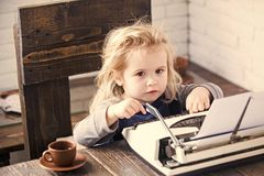 Profession of a copywriter. business kid or small boy or businessman child with typewriter. Profession of a copywriter. business kid or small businessman child royalty free stock images