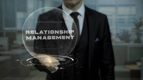 Profession tutor presenting relationship management concept with hologram on his hand. Executive career specialist looking for workers using cyber earth stock footage