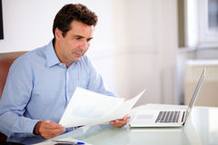 Professiona businessman looking at his documents Royalty Free Stock Photography
