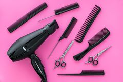 Professional accessories of hairdresser on work desk pink background top view royalty free stock photo