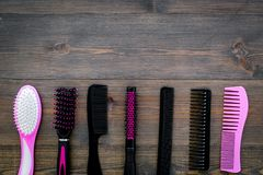 Professional accessories of hairdresser on work desk wooden background top view mock-up royalty free stock photo