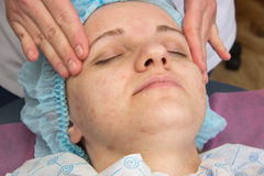Professional acne facial cleansing in the cabin. Professional cleansing of acne in a beauty salon Stock Images