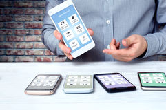 Professional adviser shows high-end smartphones Royalty Free Stock Photo