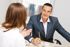 Professional advisor having a discussion with a cu Royalty Free Stock Photo