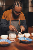 Professional African barista training to make perfect cup of cof Royalty Free Stock Photography