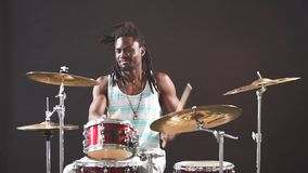 Professional african drummer man playing on drums and cymbals. Wearing eyeglasses and holding sticks stock video