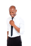 Professional african man with hand on his tie Stock Photo