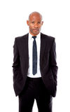 Professional african man with hands in pockets. Professional african man in a suit with his hands in his pockets shot on an isolated background Stock Photography
