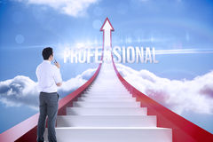 Professional against red steps arrow pointing up against sky Stock Photo