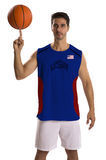 Professional American basketball player with ball. Royalty Free Stock Image