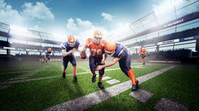 Free Professional American Football Players In The Action On Stadium Stock Photos - 77409933
