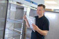 Professional appliance repair service technician stock photography