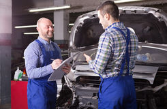 Professional appraisal of damage for repairing car. At auto station Royalty Free Stock Images