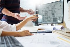 Professional architect designer structural engineer team colleagues working office looking computer discussing building plan. Design project royalty free stock images