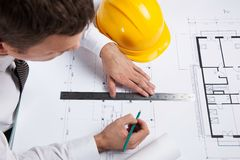Professional architect drawing construction plan. Stock Photos