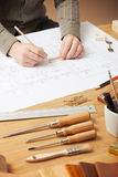 Professional architect working at his desk Royalty Free Stock Image
