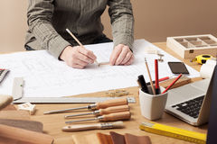 Professional architect working at his desk. Professional architect and construction engineer working at office desk hands close-up, he is drawing on a building Stock Photos