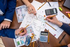 Professional architects discussing the house project stock photography