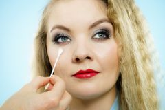 Professional artist fixing fashion model make up royalty free stock photography