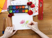Professional artist painting a rose Royalty Free Stock Images