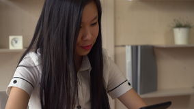 Professional assistant using touch screen tablet. Asian female use gadget and looking at the camera with happy friendly smile stock video