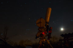 Professional astrophotography equipment working under the dark sky.  stock photography